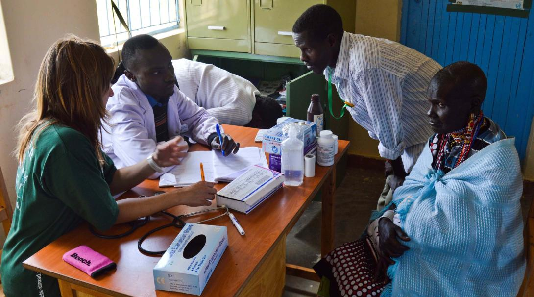 A Projects Abroad medical volunteer shadows a doctor during a medical consultation in Kenya.
